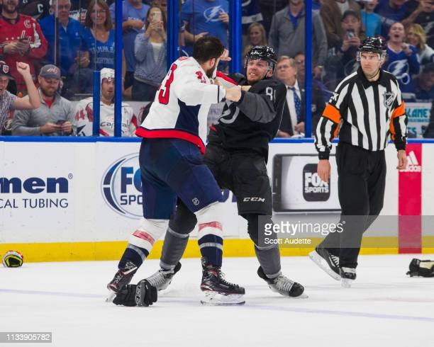 Erik Cernak of the Tampa Bay Lightning fights against Tom Wilson of the Washington Capitals at Amalie Arena on March 30 2019 in Tampa Florida