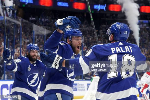 Erik Cernak of the Tampa Bay Lightning is congratulated by Ondrej Palat and Nikita Kucherov after scoring a goal against the Montreal Canadiens...