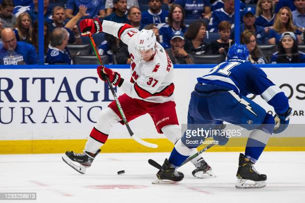 Erik Cernak of the Tampa Bay Lightning skates against Andrei Svechnikov of the Carolina Hurricanes during the second period in Game Three of the...