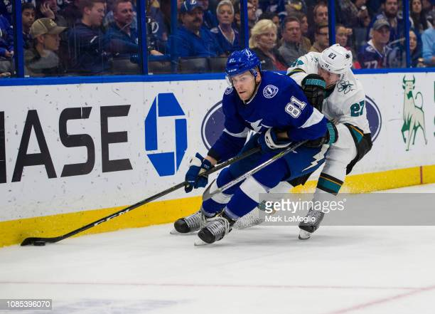 Erik Cernak of the Tampa Bay Lightning skates against Joonas Donskoi of the San Jose Sharks during the first period at Amalie Arena on January 19...