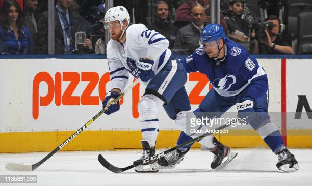 Erik Cernak of the Tampa Bay Lightning skates against William Nylander of the Toronto Maple Leafs during an NHL game at Scotiabank Arena on March 11...
