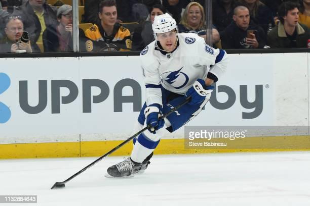 Erik Cernak of the Tampa Bay Lightning skates with the puck against the Boston Bruins at the TD Garden on February 28 2019 in Boston Massachusetts