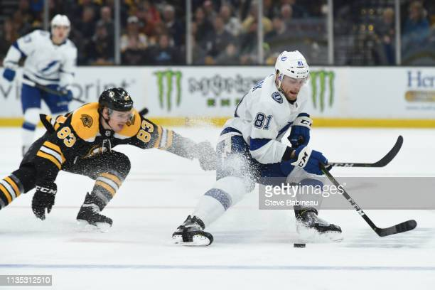 Erik Cernak of the Tampa Bay Lightning skates with the puck against Karson Kuhlamn of the Boston Bruins at the TD Garden on April 6 2019 in Boston...