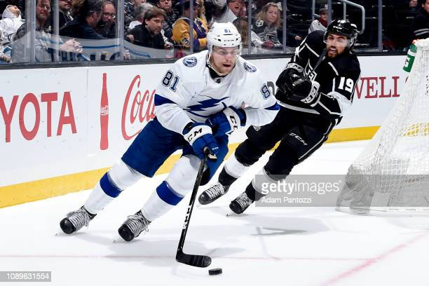 Erik Cernak of the Tampa Bay Lightning skates with the puck while pursued by Alex Iafallo of the Los Angeles Kings during the third period of the...