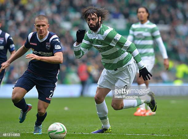 Erik Cikos of Ross County holds off Georgios Samaras of Celtic during the Scottish Premier League match between Celtic and Ross County at Celtic Park...