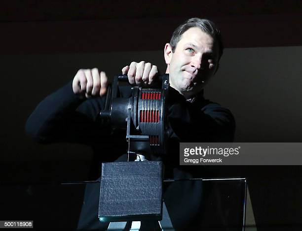 Erik Cole, former Carolina Hurricane and member of the 2006 Stanley Cup championship team, cranks the warning siren prior to an NHL game between the...
