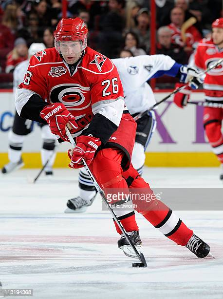 Erik Cole of the Carolina Hurricanes brings the puck up ice against the Tampa Bay Lightning during an NHL game on March 26, 2011 at RBC Center in...