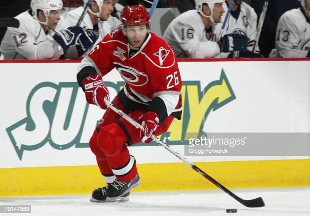 Erik Cole of the Carolina Hurricanes carries the puck against the Edmonton Oilers during the NHL game at RBC Center on January 18, 2008 in Raleigh,...