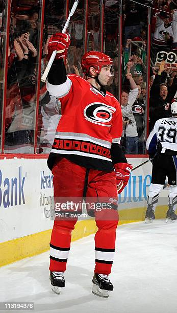 Erik Cole of the Carolina Hurricanes celebrates a goal against the Tampa Bay Lightning during an NHL game on March 26, 2011 at RBC Center in Raleigh,...