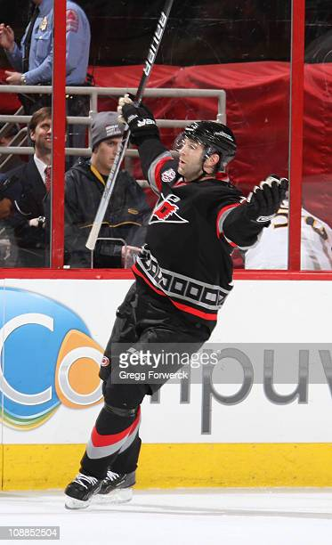 Erik Cole of the Carolina Hurricanes celebrates his game-winning goal in overtime during an NHL game against the Atlanta Thrashers on February 5,...