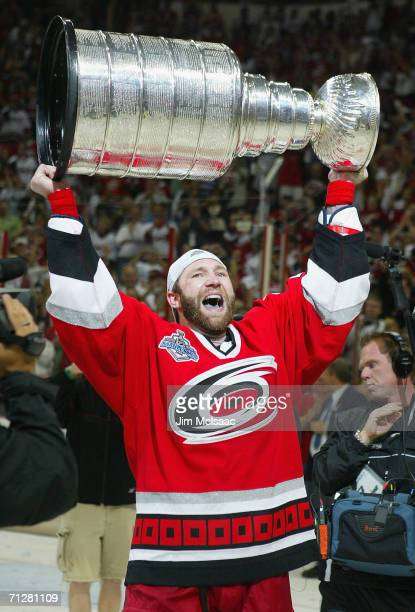 Erik Cole of the Carolina Hurricanes celebrates with the Stanley Cup after defeating the Edmonton Oilers in game seven of the 2006 NHL Stanley Cup...