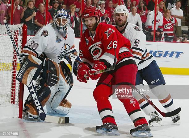 Erik Cole of the Carolina Hurricanes skates against Jussi Markkanen and Jaroslav Spacek of the Edmonton Oilers during game seven of the 2006 NHL...