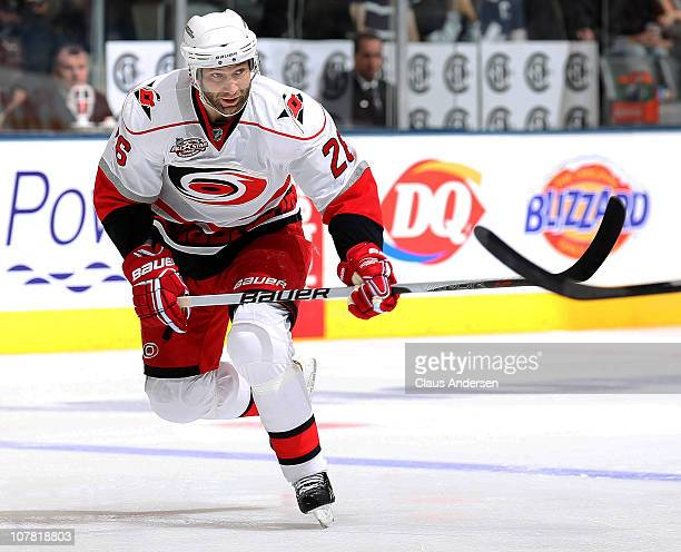 Erik Cole of the Carolina Hurricanes skates in a game against the Toronto Maple Leafs on December 28, 2010 at the Air Canada Centre in Toronto,...