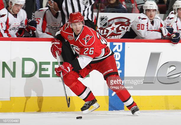 Erik Cole of the Carolina Hurricanes skates with the puck during a NHL game against the Washington Capitals on November 24, 2010 at RBC Center in...