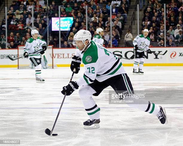 Erik Cole of the Dallas Stars controls the puck during the game against the Minnesota Wild on October 12, 2013 at Xcel Energy Center in St Paul,...