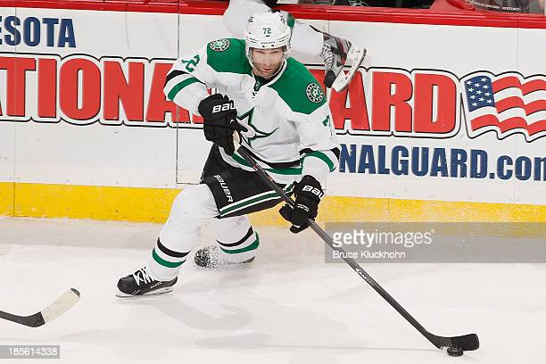 Erik Cole of the Dallas Stars handles the puck against the Minnesota Wild during the game on October 12, 2013 at the Xcel Energy Center in St. Paul,...