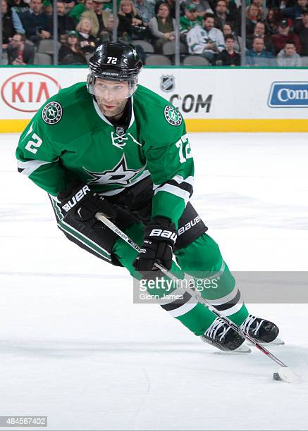 Erik Cole of the Dallas Stars handles the puck against the San Jose Sharks at the American Airlines Center on February 19, 2015 in Dallas, Texas.