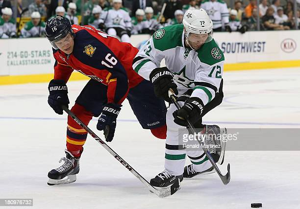 Erik Cole of the Dallas Stars skates the puck past Aleksander Barkov of the Florida Panthers during a preseason game at American Airlines Center on...