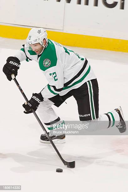 Erik Cole of the Dallas Stars skates with the puck against the Minnesota Wild during the game on October 12, 2013 at the Xcel Energy Center in St....