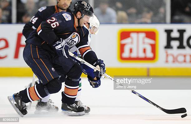 Erik Cole of the Edmonton Oilers controls the puck against the Vancouver Canucks in the third period during an NHL preseason game on September 22...