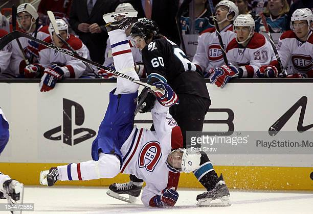 Erik Cole of the Montreal Canadiens is hit by Jason Demers of the San Jose Sharks in the third period at HP Pavilion at San Jose on December 1, 2011...
