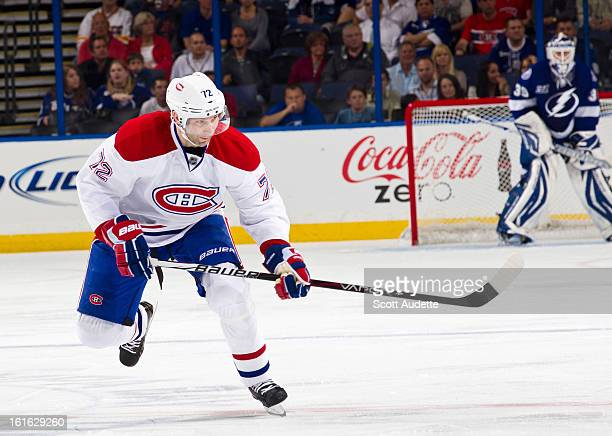 Erik Cole of the Montreal Canadiens skates during the first period of the game against the Tampa Bay Lightning at the Tampa Bay Times Forum on...
