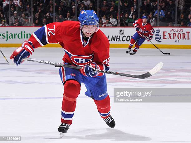 Erik Cole of the Montreal Canadiens skates hard after the puck during the NHL game against the New York Islanders on March 17, 2012 at the Bell...