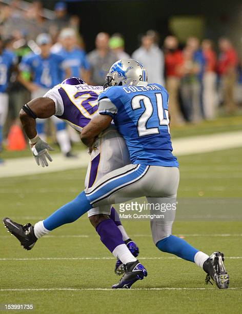 Erik Coleman of the Detroit Lions tackles Adrian Peterson of the Minnesota Vikings during the game at Ford Field on September 30 2012 in Detroit...