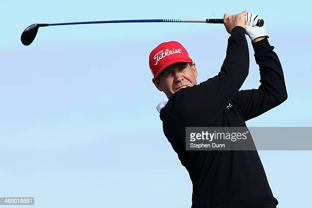 Erik Compton hits a tee shot on the 2nd hole during the third round of the Farmers Insurance Open on Torrey Pines South on January 25 2014 in La...