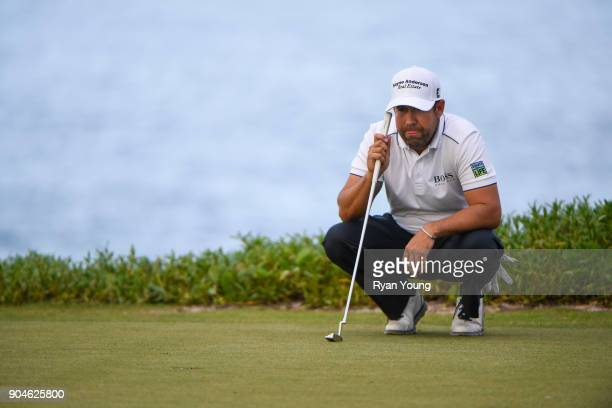 Erik Compton lines up a putt on the 14th green during the first round of the Webcom Tour's The Bahamas Great Exuma Classic at Sandals Emerald Bay...
