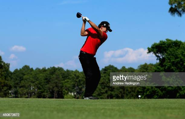 Erik Compton of the United States hits his tee shot on the fourth hole during the final round of the 114th US Open at Pinehurst Resort Country Club...