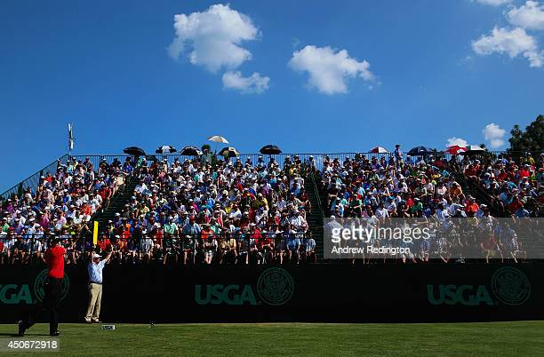 Erik Compton of the United States hits his tee shot on the sixth hole as a patrons look on during the final round of the 114th US Open at Pinehurst...
