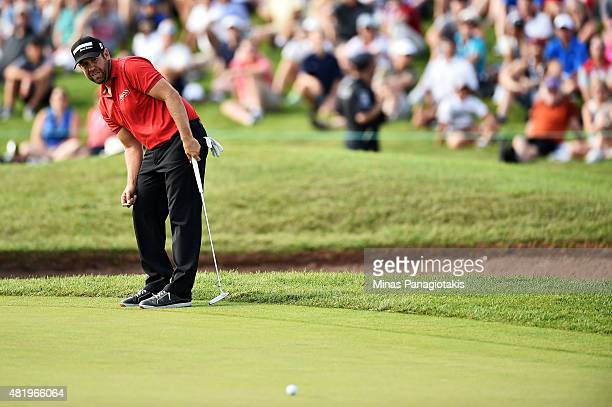 Erik Compton putts on the 18th green during round three of the RBC Canadian Open at Glen Abbey Golf Club on July 25 2015 in Oakville Canada