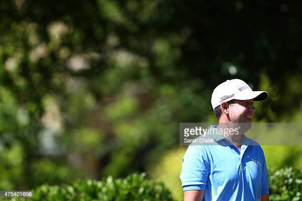 Erik Compton smiles at the gallery before hitting his tee shot on the first hole during the Final Round of the ATT Byron Nelson at the TPC Four...