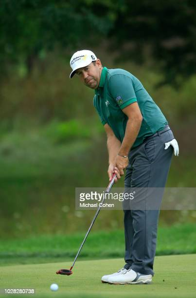 Erik Compton strokes a putt during the third round of the Nationwide Children's Hospital Championship held at The Ohio State University Golf Club on...