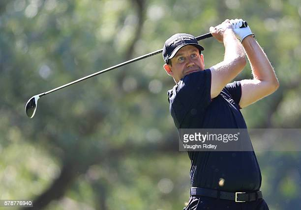 Erik Compton watches his drive on the 14th hole during the second round of the RBC Canadian Open at Glen Abbey Golf Club on July 22 2016 in Oakville...