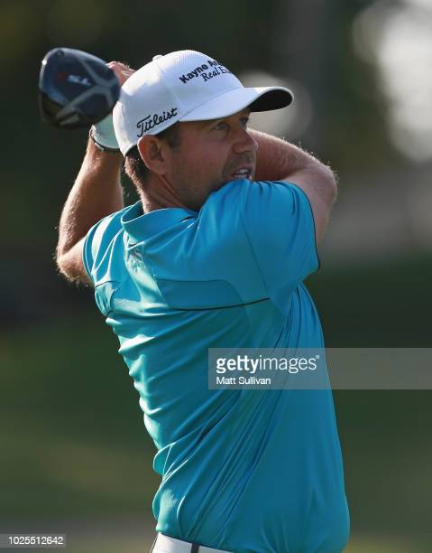 Erik Compton watches his tee shot on the 15th hole during the second round of the Webcom Tour DAP Championship at Canterbury Golf Club on August 31...