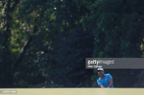 Erik Compton watches his third shot on the 15th hole during the second round of the Webcom Tour DAP Championship at Canterbury Golf Club on August 31...