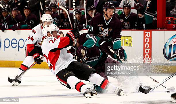 Erik Condra of the Ottawa Senators and Ben Lovejoy of the Anaheim Ducks fall while pursuing the puck during a game at Honda Center on October 13 2013...