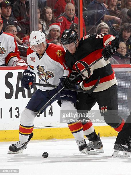 Erik Condra of the Ottawa Senators battles for the puck against Tomas Fleischmann of the Florida Panthers during an NHL game at Canadian Tire Centre...