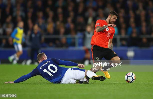 Erik Daniel of MFK Ruzomberok is tackled by Wayne Rooney of Everton during the UEFA Europa League Third Qualifying Round First Leg match between...