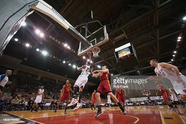 Erik Daniels, #23 Erie Bayhawks, shoots a layup over the Fort Wayne Mad Ants defense during a NBA D-League game between the Fort Wayne Mad Ants and...