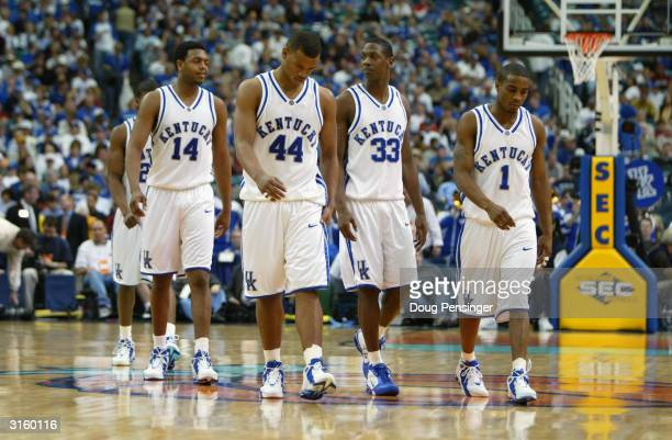 Erik Daniels Chuck Hayes Antwain Barbour and Cliff Hawkins of the Kentucky Wildcats walk towards the sideline during the SEC Men's Basketball...