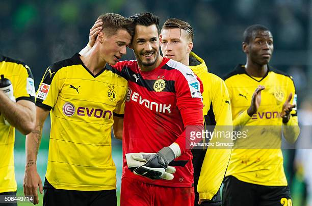 Erik Durm and goal keeper Roman Buerki of Borussia Dortmund after the final whistle during the Bundesliga match between Borussia Moenchengladbach and...