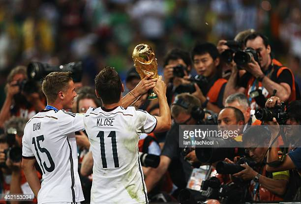 Erik Durm and Miroslav Klose of Germany lift the trophy during the 2014 World Cup final match between Germany and Argentina at The Maracana Stadium...