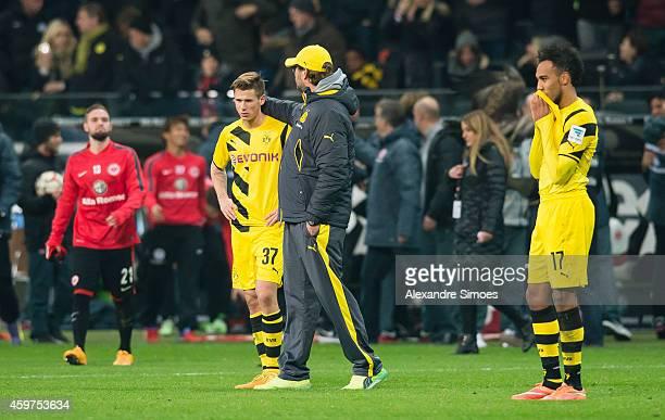 Erik Durm head coach Juergen Klopp and PierreEmerick Aubameyang of Dortmund look dejected after the final whistle during the Bundesliga match between...