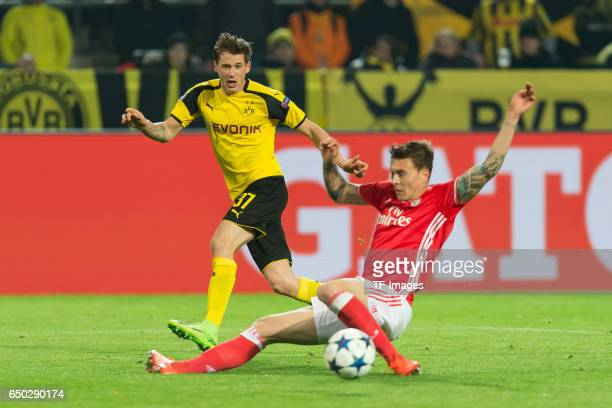 Erik Durm of Borussia Dortmund and Victor Lindeloef of Benfica battle for the ball vorlage zum 40 durch PierreEmerick Aubameyang of Borussia Dortmund...