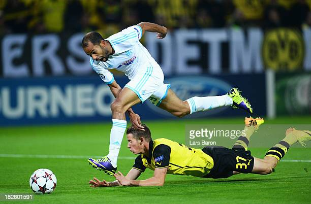 Erik Durm of Borussia Dortmund challenges for the ball with Saber Khalifa of Olympique Marseille during the UEFA Champions League Group F match...