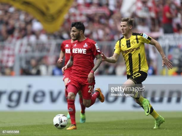 Erik Durm of Borussia Dortmund challenges with Leonardo Bittencourt of 1FC Cologne during the Bundesliga soccer match between Borussia Dortmund and...