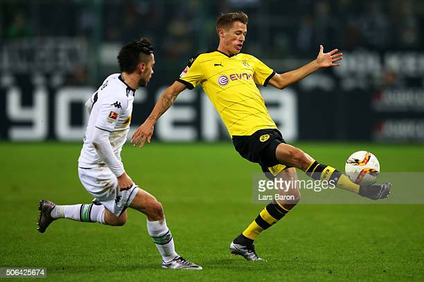Erik Durm of Borussia Dortmund is watched by Julian Korb of Borussia Moenchengladbach during the Bundesliga match between Borussia Moenchengladbach...